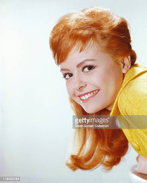 Headshot of Deborah Walley US actress smiling in a studio portrait against a white background circa 1960