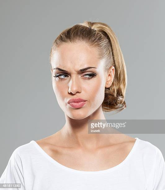 headshot of disappointed blond hair young woman - ponytail stock pictures, royalty-free photos & images