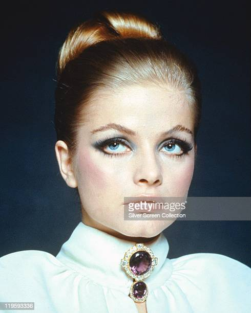 Headshot of Ewa Aulin Swedish actress wearing a white highnecked jacket with an amethyst brooch circa 1970