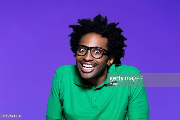 headshot of excited young man with dreadkocks looking away - funky stock pictures, royalty-free photos & images