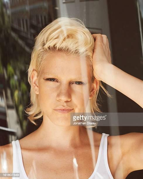 Headshot of female captured through glass