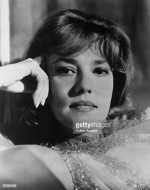 Headshot of French actor Jeanne Moreau holding her hand to her temple.