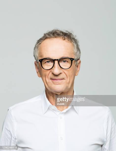 headshot of friendly senior businessman - headshot stock pictures, royalty-free photos & images