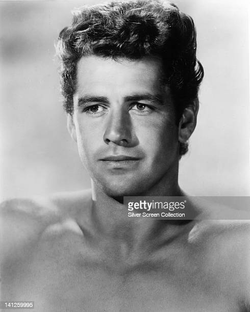 Headshot of Gordon Scott , US actor, bare chested in a studio portrait, against a light background, circa 1955. Scott is best known for his portrayal...