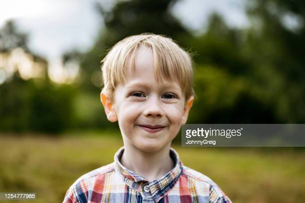 headshot of happy 6 year old caucasian boy with blond hair - one boy only stock pictures, royalty-free photos & images