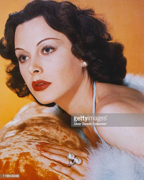 Headshot of Hedy Lamarr , Austrian actress, leaning against velour-covered surface, in a studio portrait, 1940.