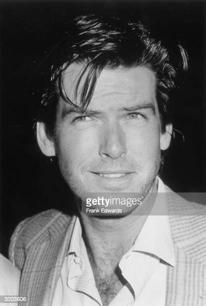 Headshot of Irishborn actor Pierce Brosnan wearing a tweed jacket with an opencollared shirt knitting his brows while smiling at the Century Plaza...