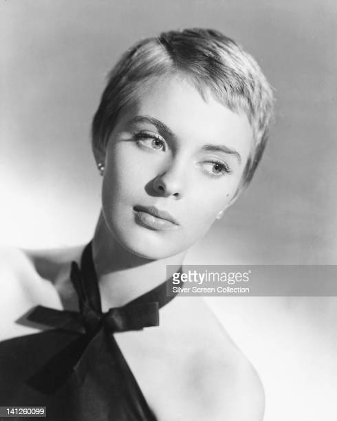 Headshot of Jean Seberg , US actress, her eyes glancing to the right of the image, wearing a black halterneck top in a studio portrait, against a...
