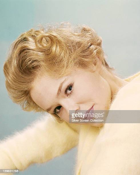Headshot of Joey Heatherton US actress dancer and singer wearing a yellow mohair jumper circa 1965