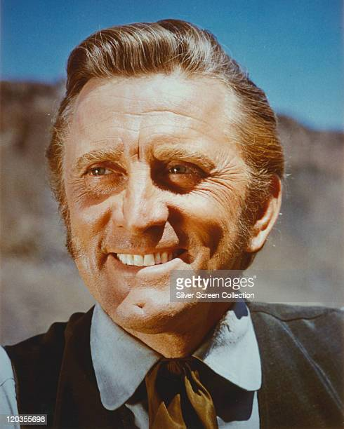 Headshot of Kirk Douglas US actor smiling in a publicity portrait circa 1960