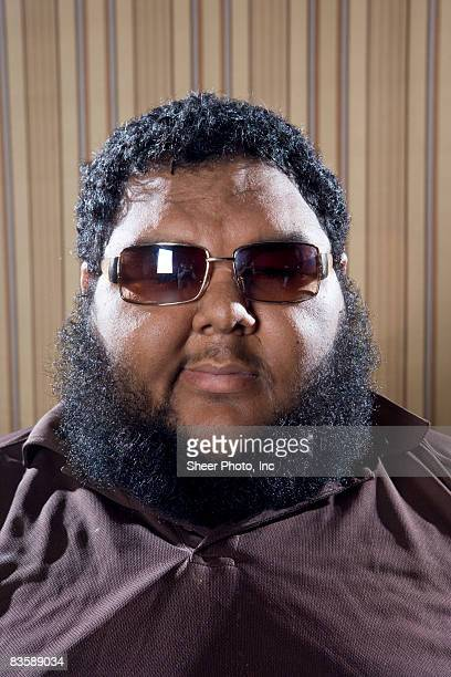 headshot of large man wearing sunglasses - fat black man stock photos and pictures