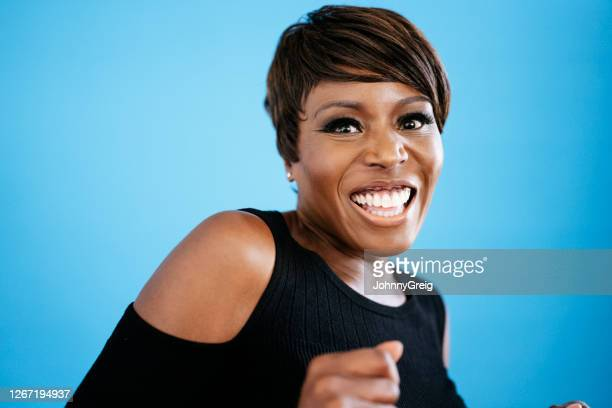 headshot of late 40s fashionable black woman dancing - 45 49 years stock pictures, royalty-free photos & images