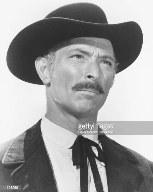Headshot of Lee Van Cleef , US actor, wearing a black wide-brimmed hat and a black Western bow tie in a publicity still issued for the film, 'For a...