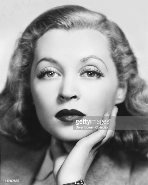 Headshot of Lilli Palmer German actress with her chin resting on her right hand in a studio portrait circa 1945