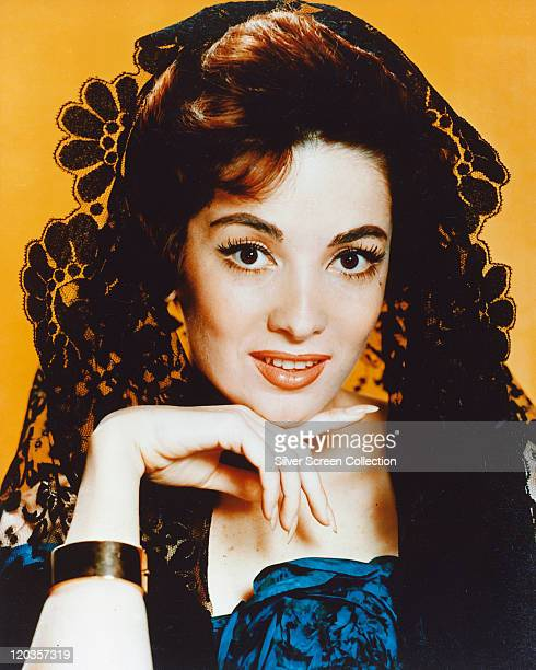Headshot of Linda Cristal Argentinian actress wearing a black lace veil in a studio portrait issued as publicity for the US television series 'The...