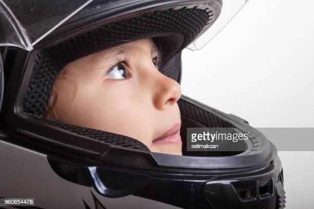 Headshot Of Little Girl Wearing Motorbike Helmet