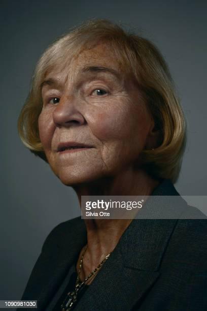Headshot of mature blonde woman looking at camera