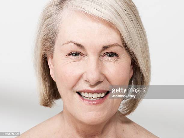 Headshot of mature woman with gray hair