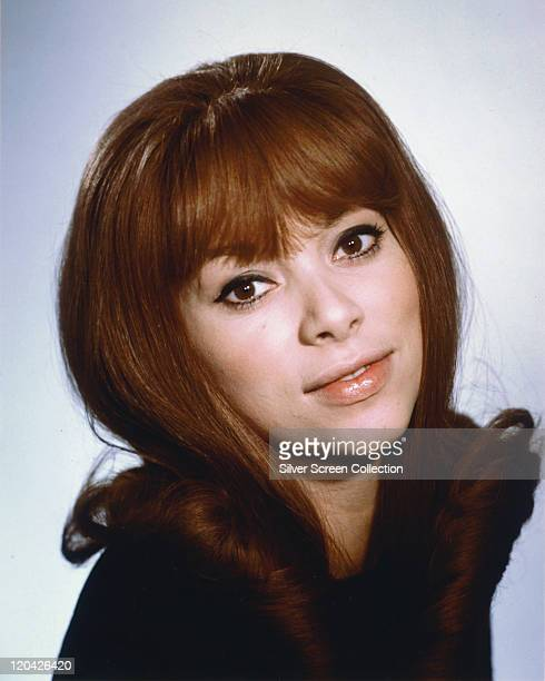 Headshot of Mireille Darc, French model and actress, in a studio portrait, against a white background, circa 1960.