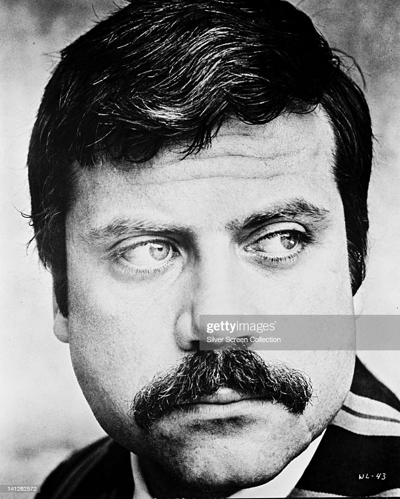 Headshot of Oliver Reed (1938-1999), British actor, with a moustache, his eyes glancing to the right of the image, in a publicity still issued for the film, 'Women in Love', 1969. The drama, adapted from the novel by D H Lawrence (1885-1930), and directed by Ken Russell (1927-2011), starred Reed as 'Gerald Crich'.