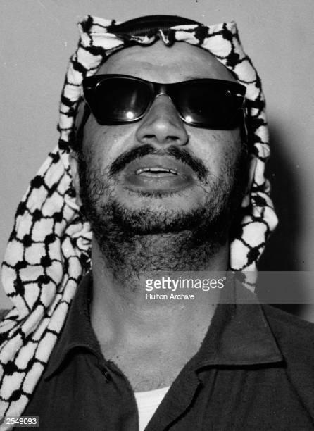 Headshot of Palestinian political leader Yasser Arafat head of the PLO wearing sunglasses c 1969