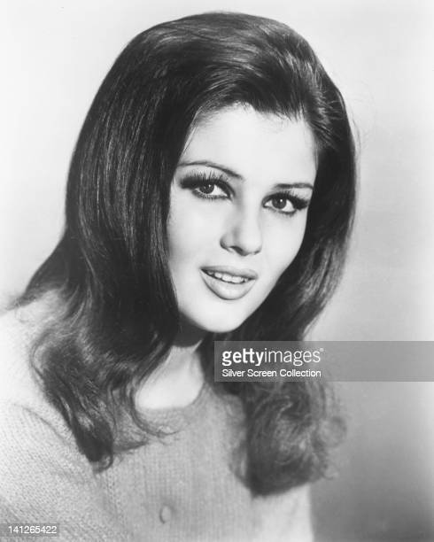 Headshot of Pamela Tiffin US actress wearing a knitted cardigan in a studio portrait against a white background circa 1965