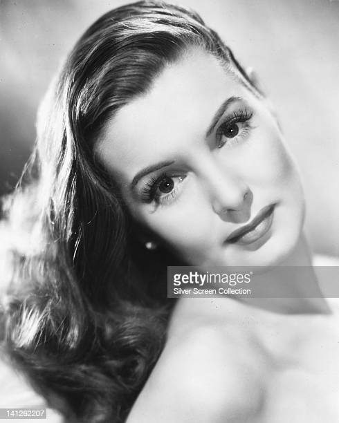 Headshot of Patricia Roc British actress with bare shoulders in a studio portrait against a white background circa 1945
