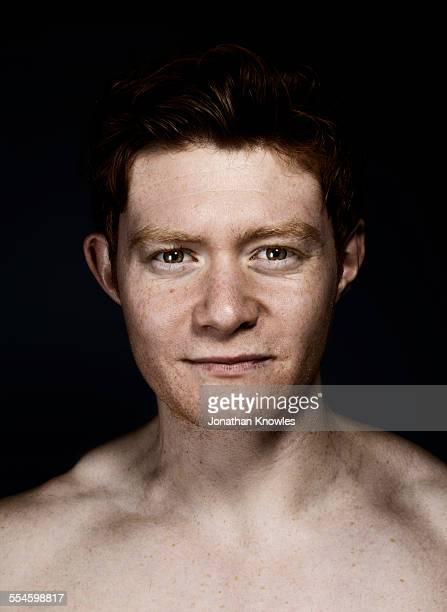 Headshot of shirtless male