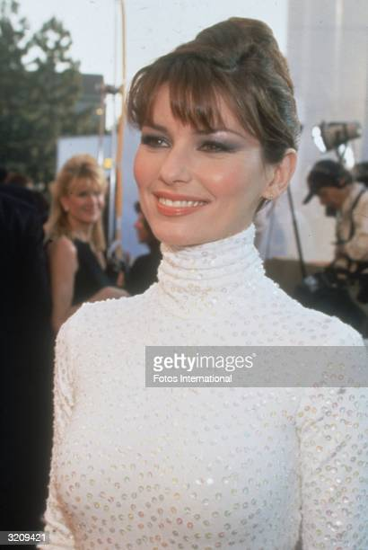 Headshot of singer Shania Twain at The Grammy Awards Los Angeles California Twain wears a white turtleneck covered in rhinestones