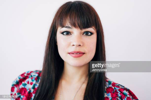 headshot of smiling mixed race woman in early 40s - fringe dress stock pictures, royalty-free photos & images