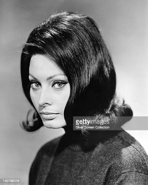 Headshot of Sophia Loren Italian actress in a studio portrait against a grey background circa 1950