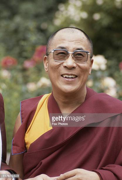 Headshot of the Dalai Lama leader of the Gelugpa lineage of Tibetan Buddhism during a visit to Lambeth Palace the official London residence of the...