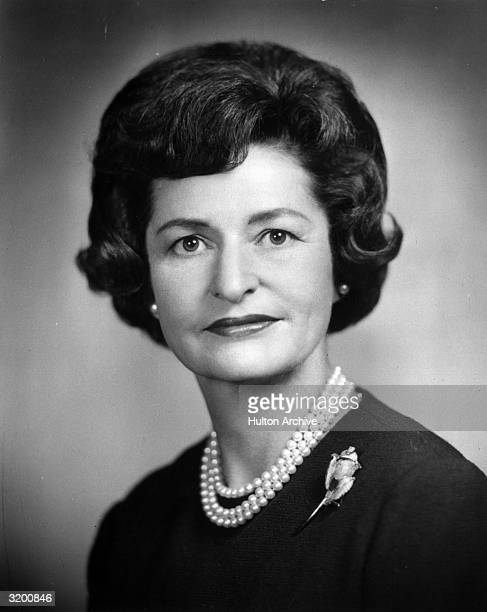 Headshot of Vice President Lyndon B Johnson's wife Lady Bird wearing a pearl necklace and a rose brooch on her sweater