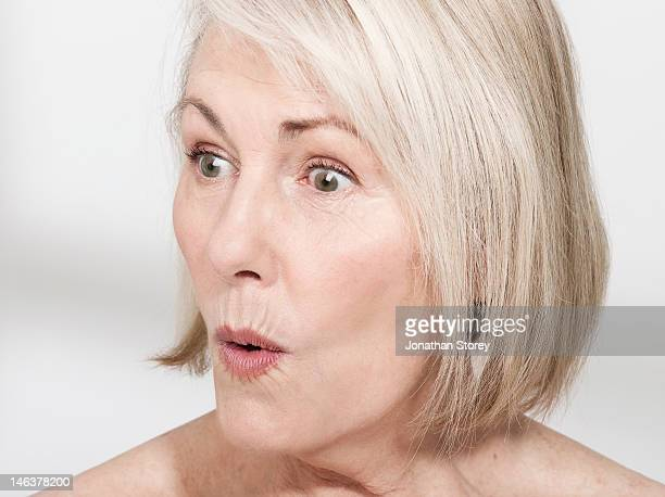 headshot of woman pursing lips looking surprised