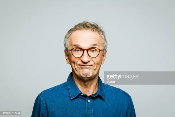 headshot of worried senior man - grimacing stock pictures, royalty-free photos & images