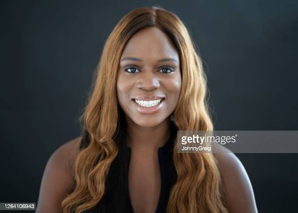 headshot of young black woman with wavy long hair - sleeveless stock pictures, royalty-free photos & images