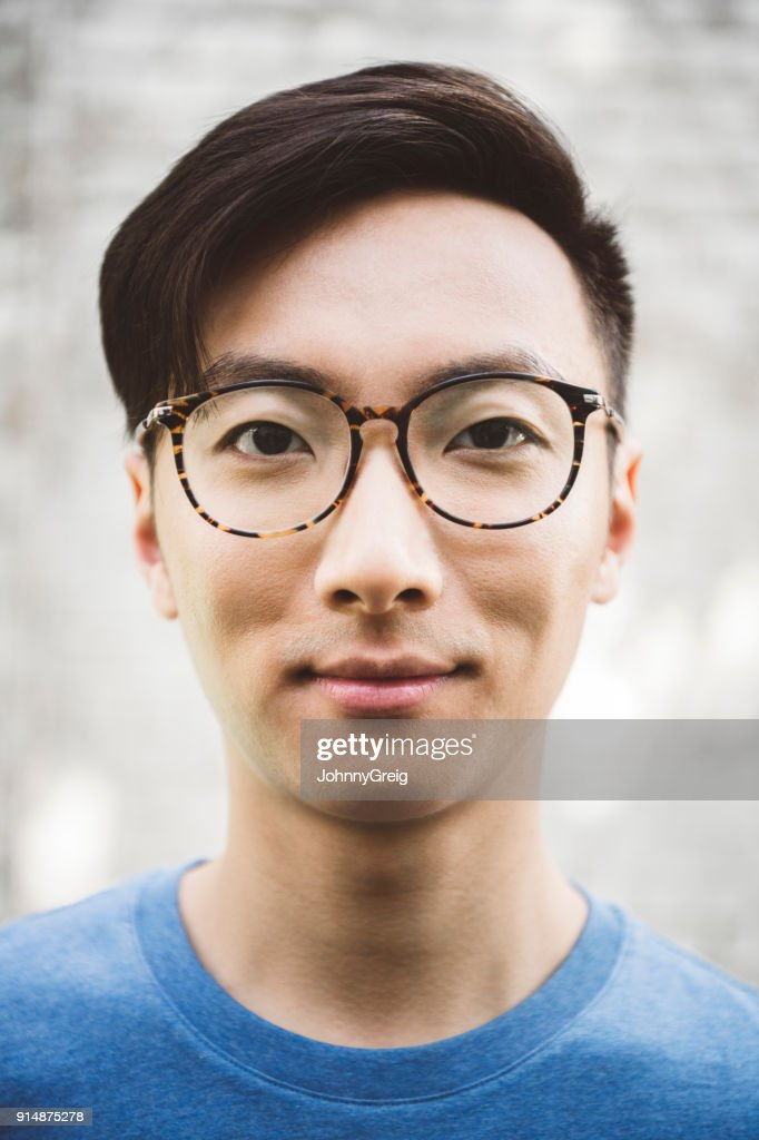 Headshot Portrait Of A Young Asian Man With Glasses Foto de stock ... 5622307496