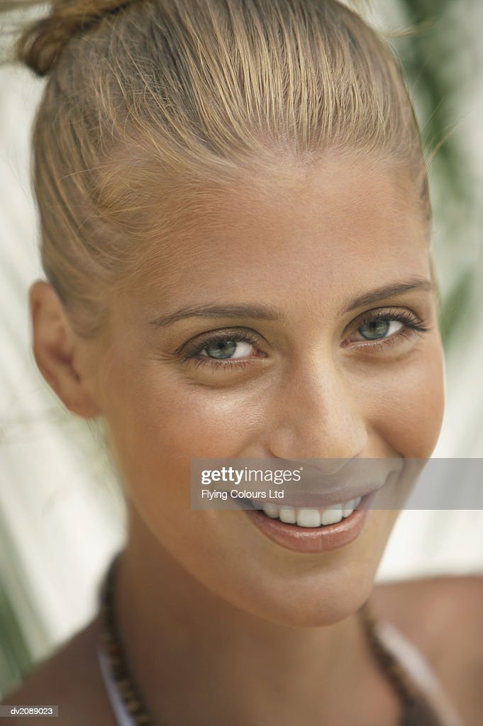 Headshot Portrait of a Young Woman With Blonde Hair : Stock Photo