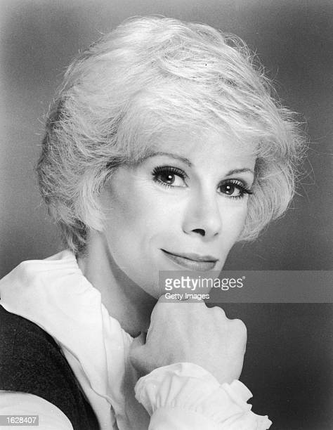 Headshot portrait of American comedian Joan Rivers leaning her face against her fist 1960s