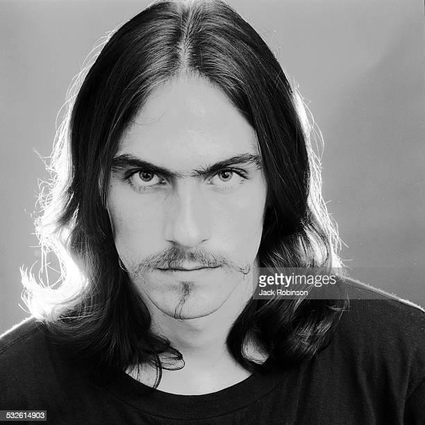 Headshot portrait of American folk musician James Taylor wearing a dark shirt May 20 1969