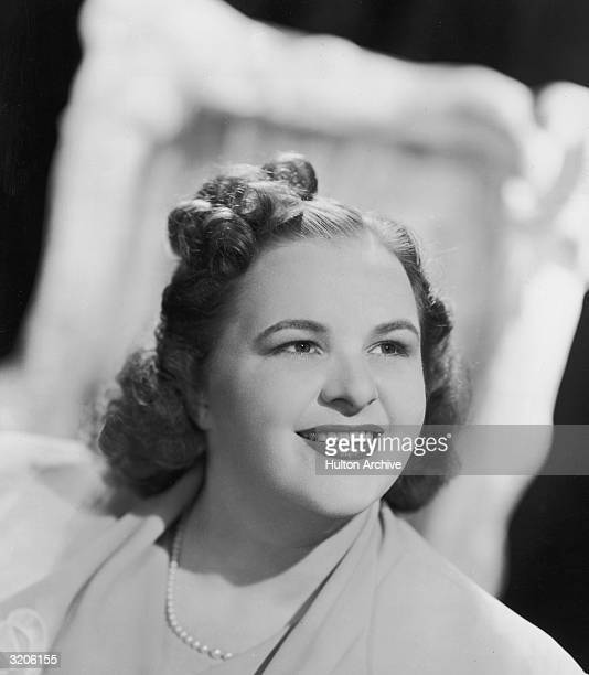 Headshot portrait of American vocalist Kate Smith smiling