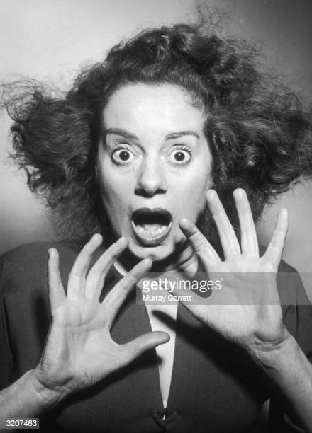 Headshot portrait of Britishborn actor Elsa Lanchester in a wideeyed frightened pose with her hands raised in front of her face Los Angeles California