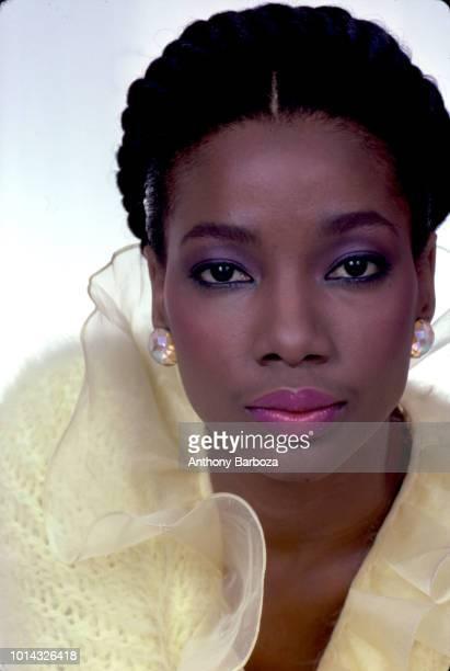 Headshot portrait of fashion model Monia framed in yellow chiffon New York 1970s