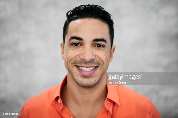 headshot portrait of happy mid adult hispanic businessman - 35 39 years stock pictures, royalty-free photos & images