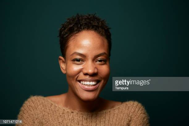 headshot portrait on plain background. - afro caribbean ethnicity stock pictures, royalty-free photos & images