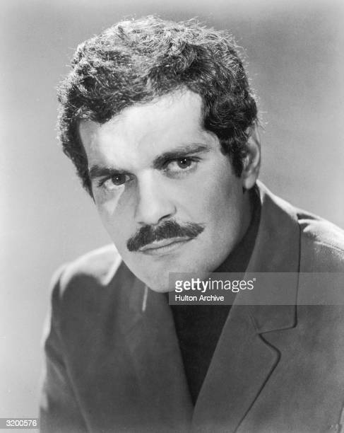 Headshot promotional portrait of Egyptian actor Omar Sharif as the Yugoslavian partisan in British director Anthony Asquith's film, 'The Yellow Rolls...