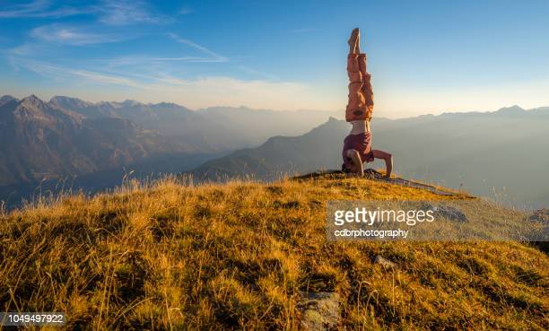 headstand yoga in the swiss alps - yogi stock pictures, royalty-free photos & images