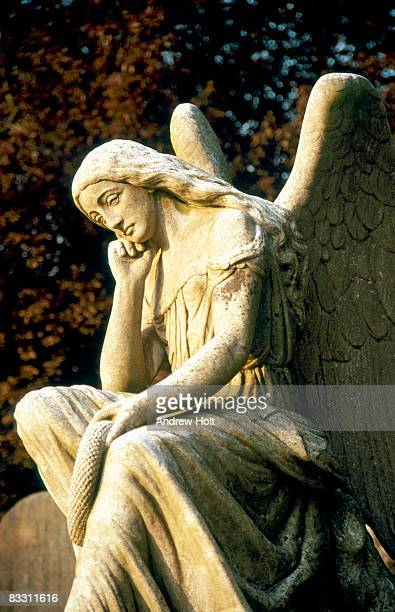 headstone angel carved sculpture in graveyard  - death stock pictures, royalty-free photos & images