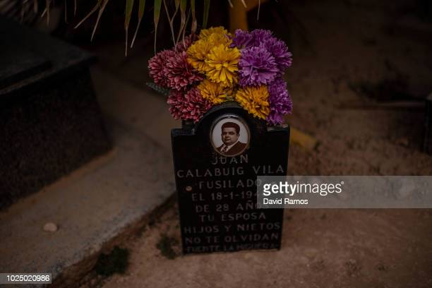 Headstone of a victim executed by Franco's regime stands next to the mass grave number 112 at the cementery of Paterna on August 28, 2018 in Paterna,...