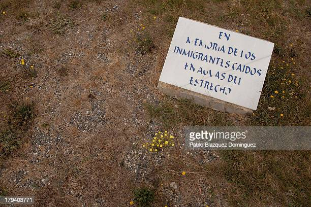 A headstone that reads 'In memory of those immigrants who died in the Strait of Gibraltar waters' remains on top of a mass grave containing nine...